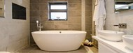 A well presented bathroom with a standing bath