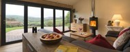 A close view out through Origin's closed doors from within a barn conversion
