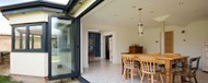 Origin bifold doors fully open looking into the kitchen and dining area