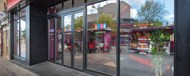 A close up of the shopfront windows of a Plymouth ice cream parlour