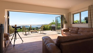 Bi-fold doors change the way this family use their coastal home